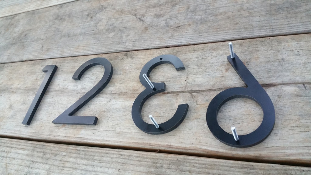 4 modern house numbers black metal composite stud mounted address numbers and letters minimalist