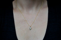 Beacon Necklace with rainbow moonstone and gray diamond on model