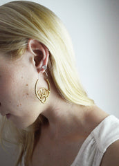 Large gold hoops on