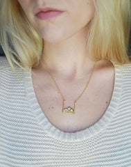 Mountain Necklace in gold on model
