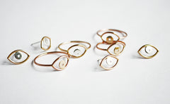 Evil Eye Rings and Earrings by Stefanie Sheehan