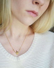 Gold necklace with flame pendant