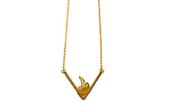 Gold necklace with triangular pendant