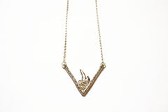 Silver necklace with triangular flame pendant