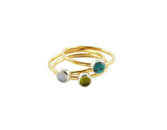 Thin gold stacking rings with gemstones