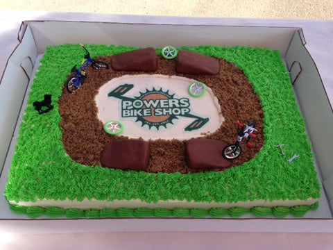Powers bike shop opening day cake