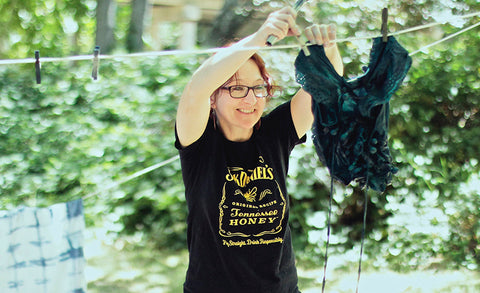 Student smiling while hanging up shibori
