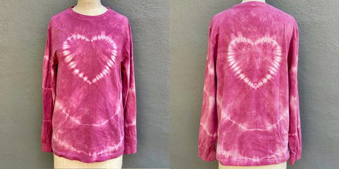 Photo of front and back of shibori t shirt with a heart design on front and back