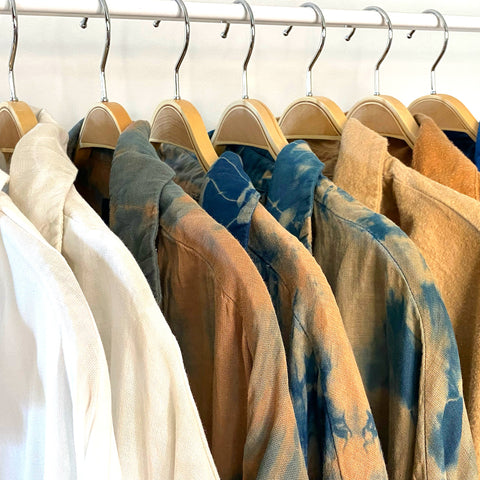 Here's a rack of clothing I dyed. Each piece is made from organic fabric and natural dyes.