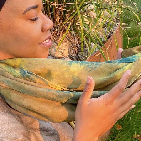 woman holding scarf