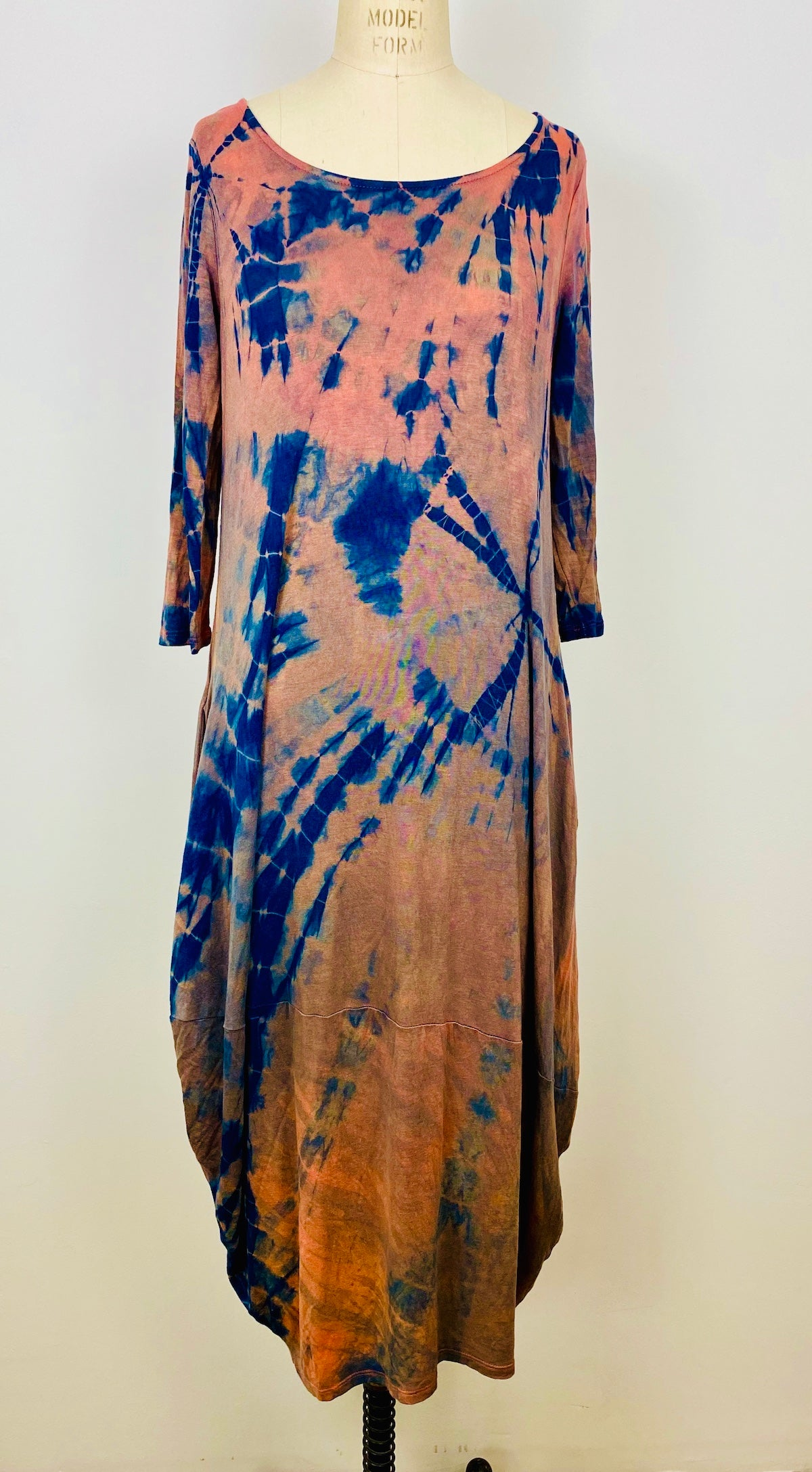 This is a full length photo of the shibori dress in coral This is a full length photo of the shibori dress in coral blue willow. It's hand dyed using indigo and madder root.blue willow. It's hand dyed using indigo.