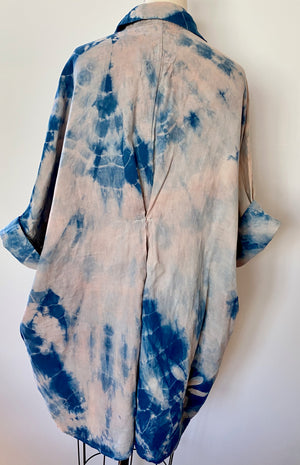 This is the back view of an organic cotton Smock Top for women by Modern Shibori. It's hand dyed with botanical dyes using madder and indigo plus shibori techniques.