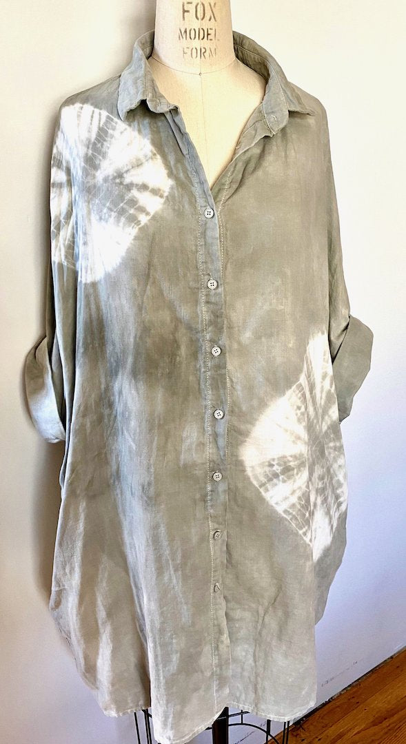 This is an organic cotton Smock Top for women by Modern Shibori. It's hand dyed with botanical dyes using rosemary and shibori techniques.