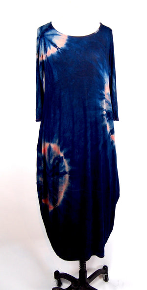 This is a full length photo of the shibori dress in pink and blue eclipse. It's hand dyed using madder root and indigo.