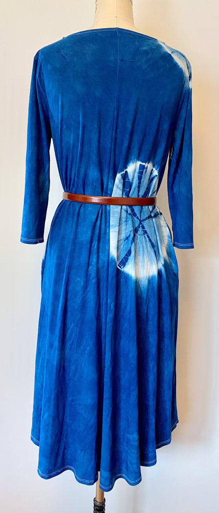 This is the back view of a different way of styling the shibori dress in blue eclipse. You can take the pockets out and tie them together for a new look. It's hand dyed using indigo.
