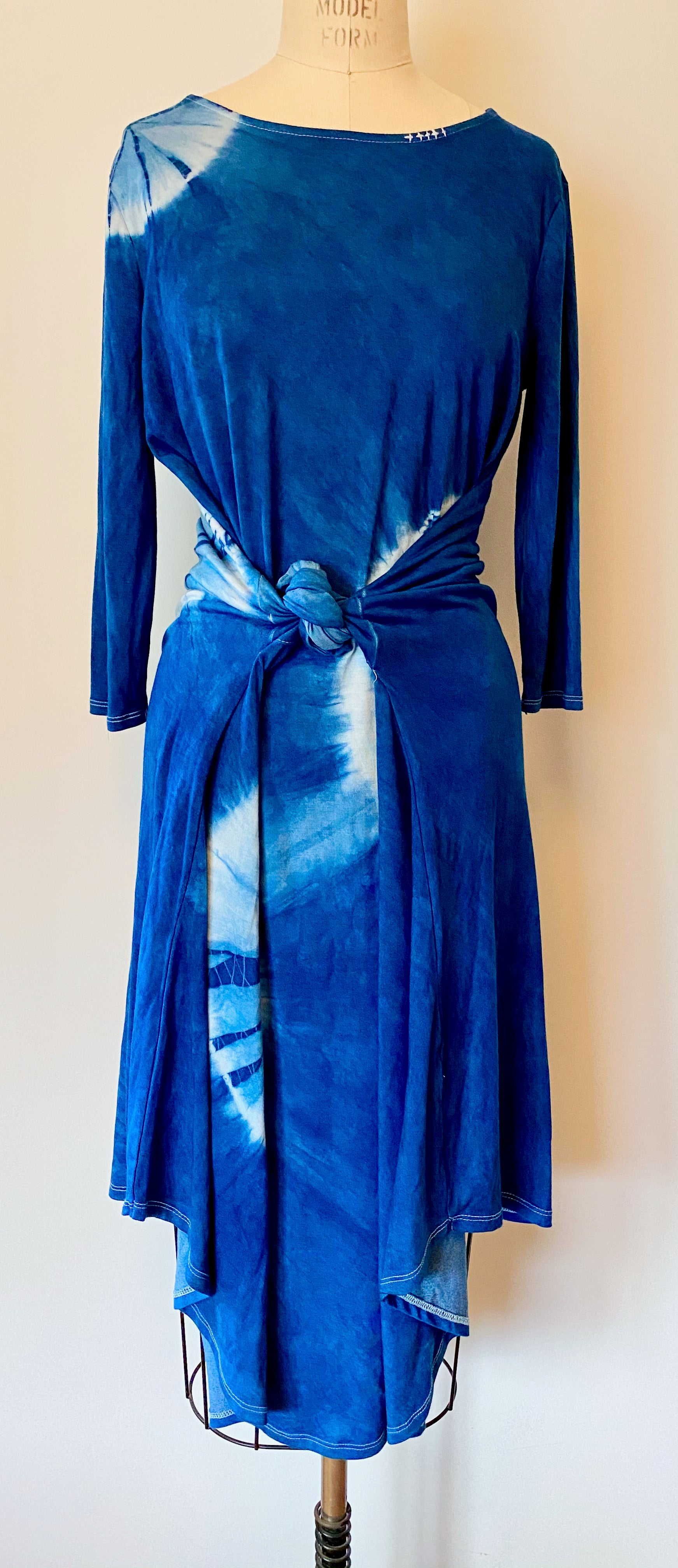 This is a full length photo of the shibori dress in blue eclipse. It's hand dyed using indigo.
