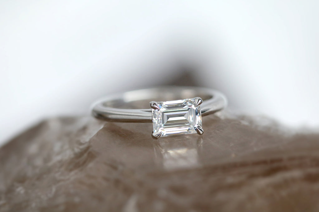 east west emerald cut engagement ring