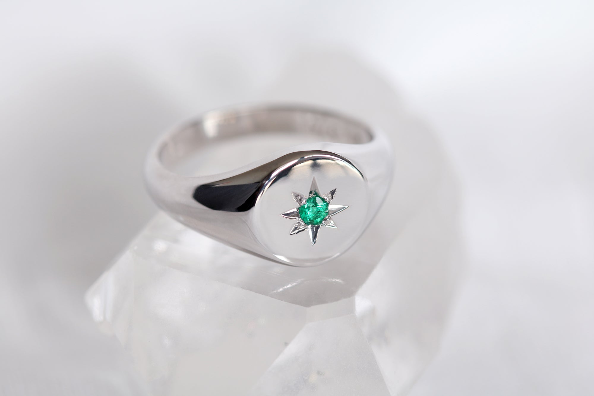 white gold signet ring with star set emerald