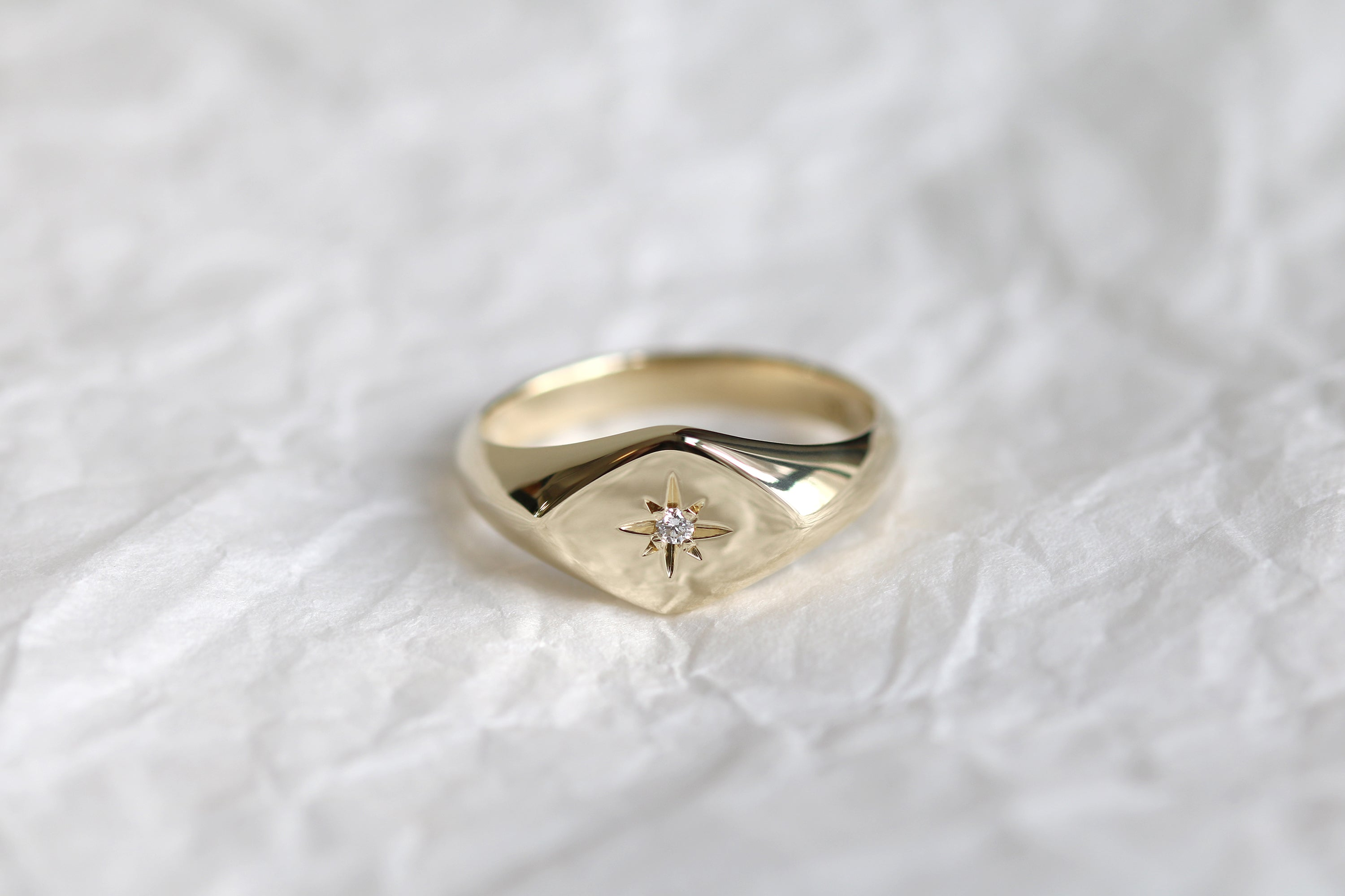 yellow gold signet ring with diamond