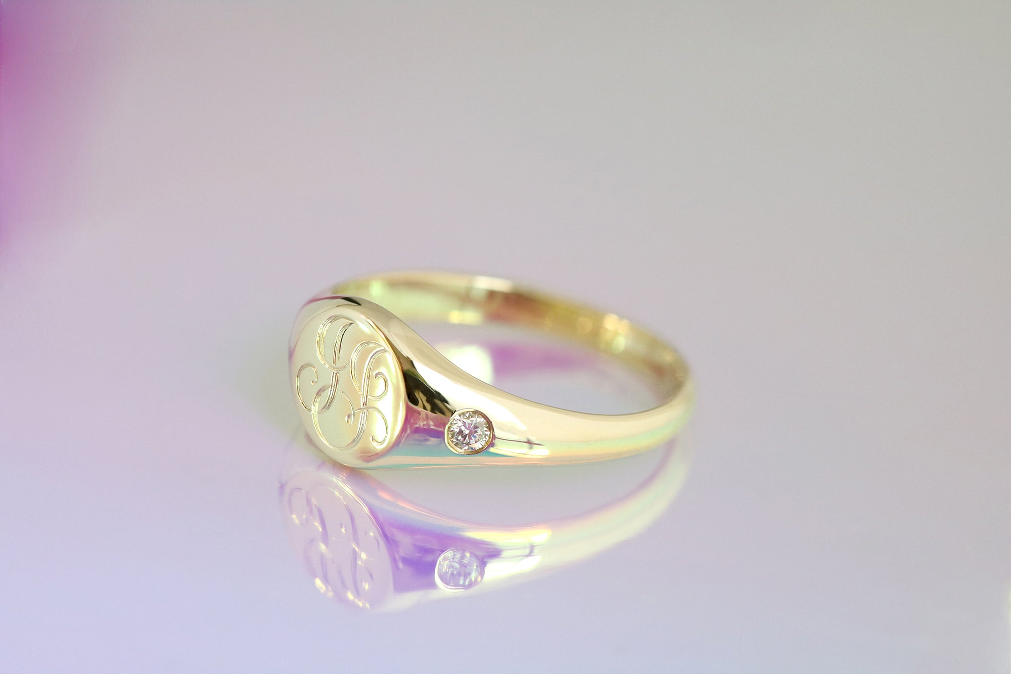 engraved signet ring with diamonds