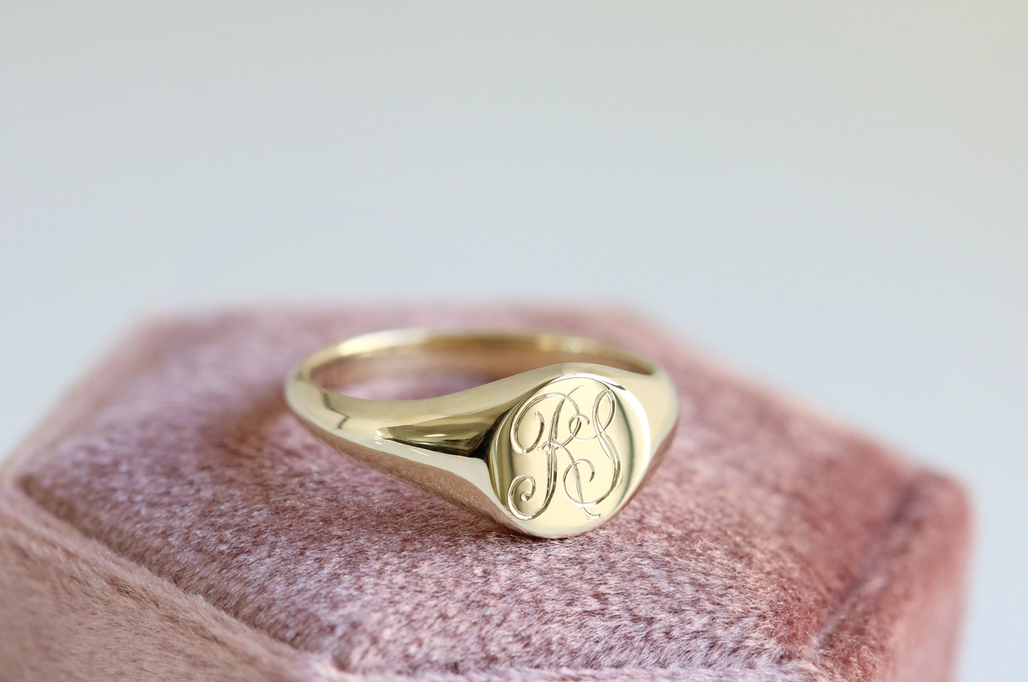 engraved initial signet ring in yellow gold