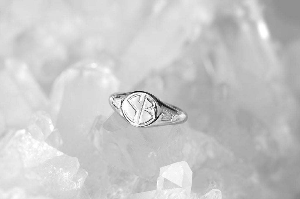 initial signet ring with tapered baguette side diamonds