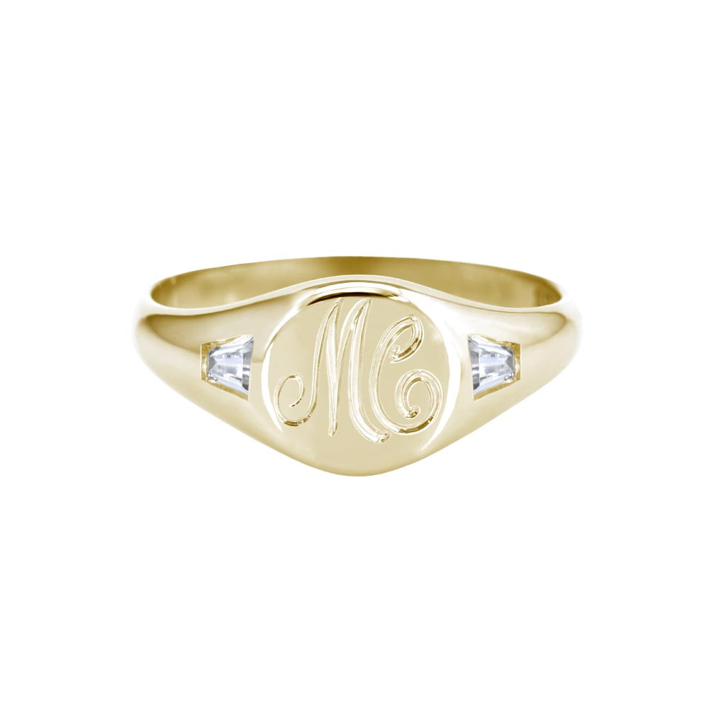 yellow gold initial signet ring with tapered baguette diamonds