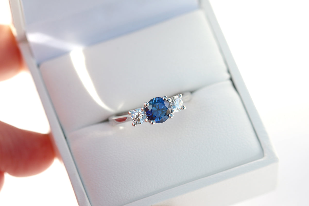 blue sapphire and diamond three stone engagement ring