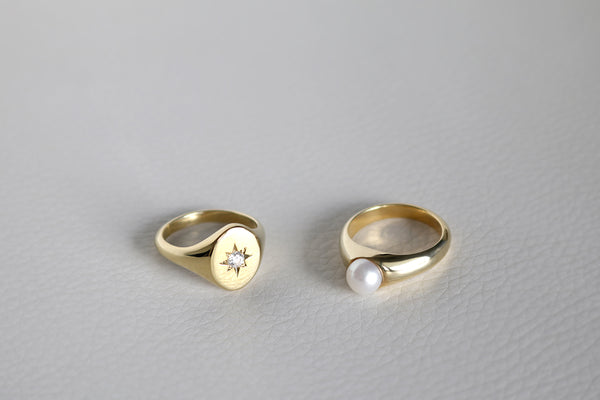 yellow gold pearl signet ring and diamond signet ring