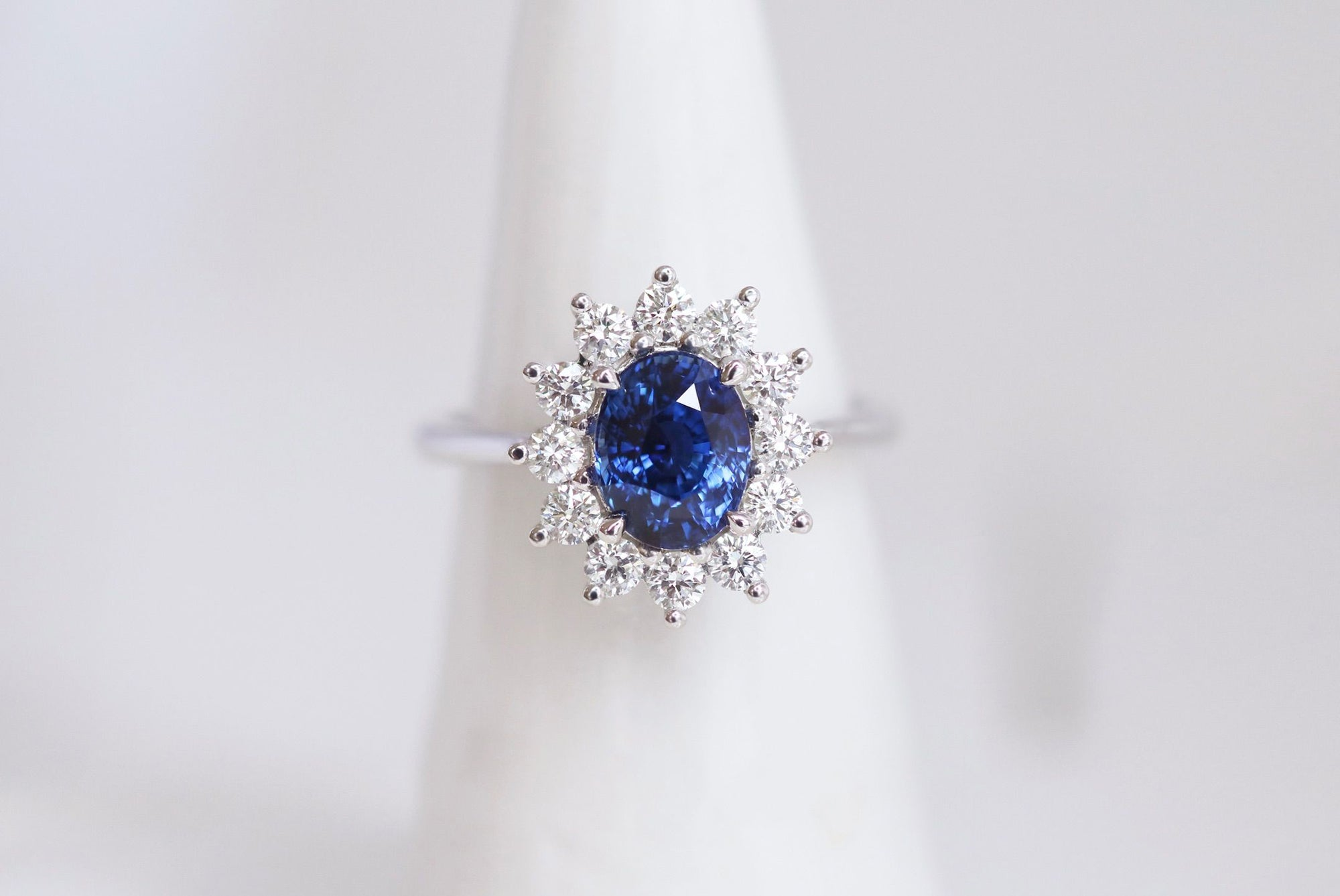 White Gold Engagement Ring with Ceylon Sapphire and diamond halo