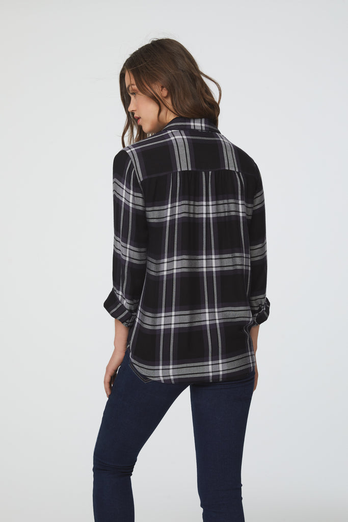 Back View Woman wearing a black and white plaid, Long Sleeve Collared V-Neck Shirt with Wrap Silhouette and Elastic Bottom Hem