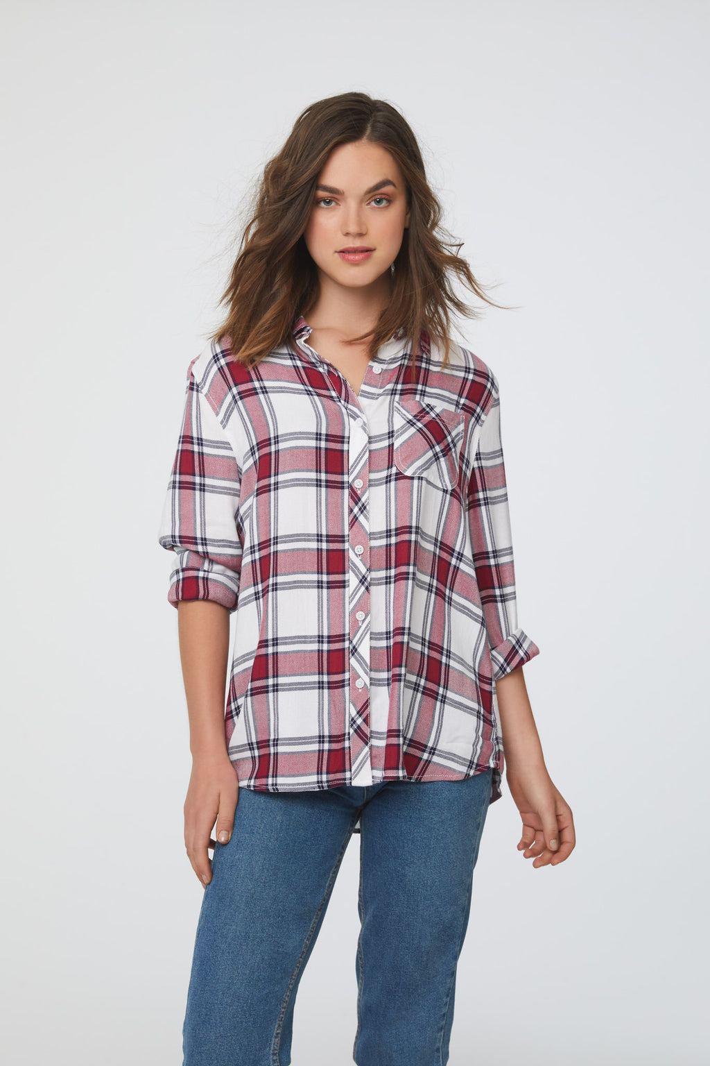 woman wearing a long sleeve, white and red plaid, button-down shirt with single chest pocket