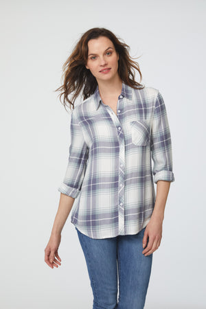 woman wearing a long sleeve, white, green and blue plaid, button-down shirt with single chest pocket