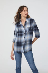 woman wearing a long sleeve, button-down, blue and black plaid shirt with single chest pocket