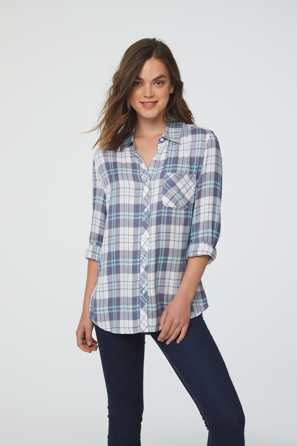 woman wearing a long sleeve, white, purple and blue plaid, button-down shirt with single chest pocket