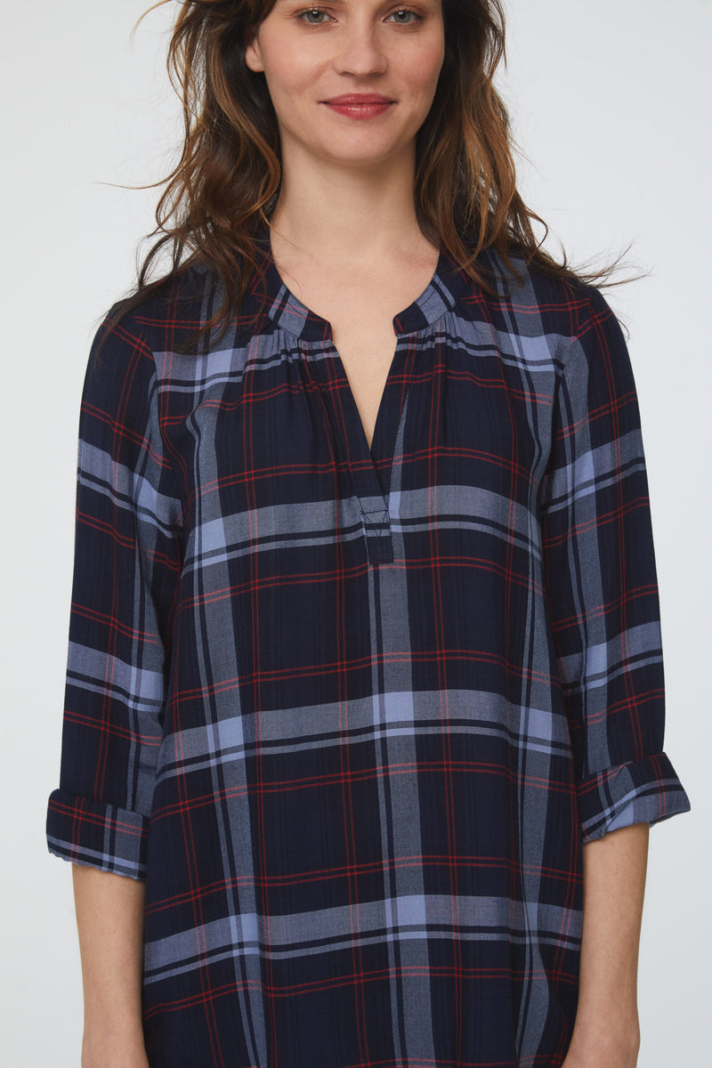 Close-up of woman wearing long sleeve, relaxed fit V-Neck Shirt in blue plaid