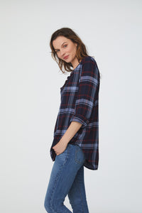 Woman wearing long sleeve, relaxed fit V-Neck Shirt in blue plaid