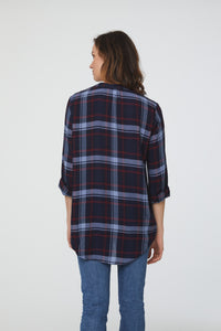 back of Woman wearing long sleeve, relaxed fit V-Neck Shirt in blue plaid