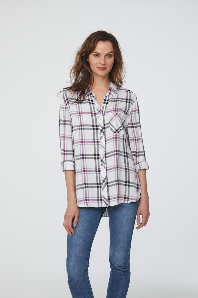 woman wearing a long sleeve, white, purple and black plaid, button-down shirt with single chest pocket