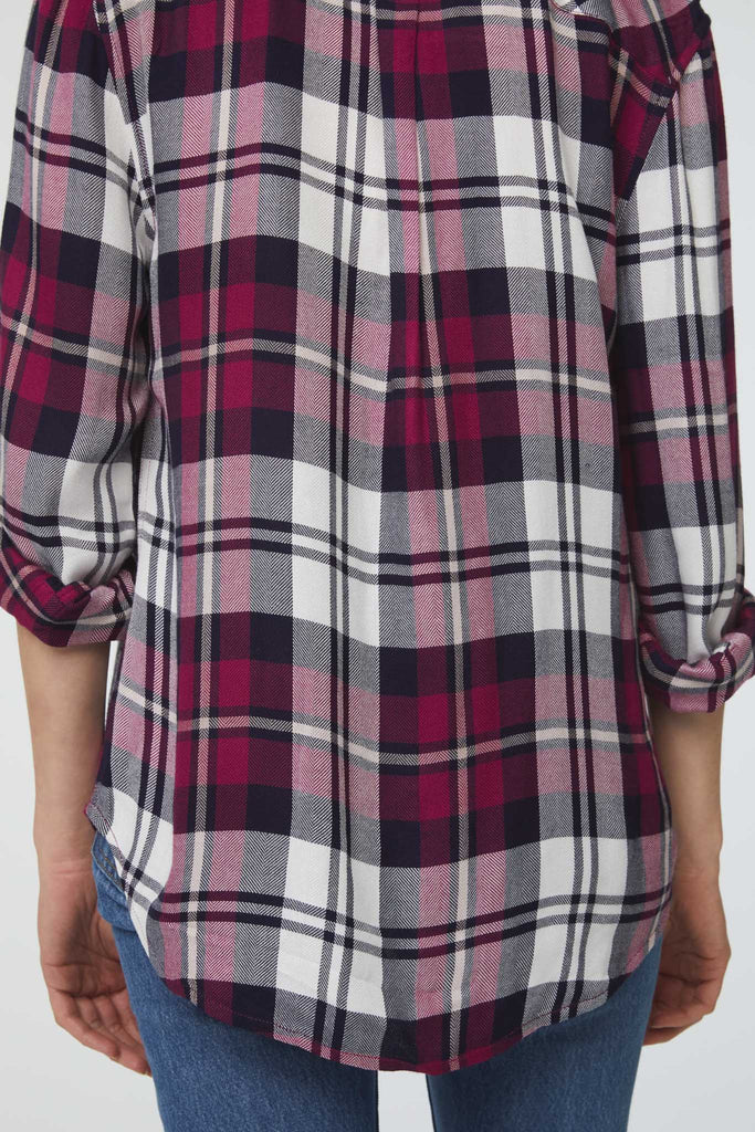 back details of white purple and black plaid shirt