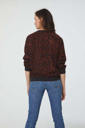 Back view of faded red and black leopard print, lightweight bomber jacket