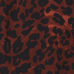 faded red and black leopard print fabric