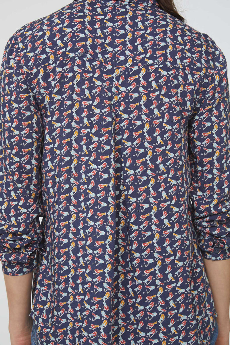 back details of blue, bird-print blouse with drop hem