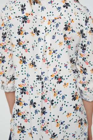 back details of white floral print blouse