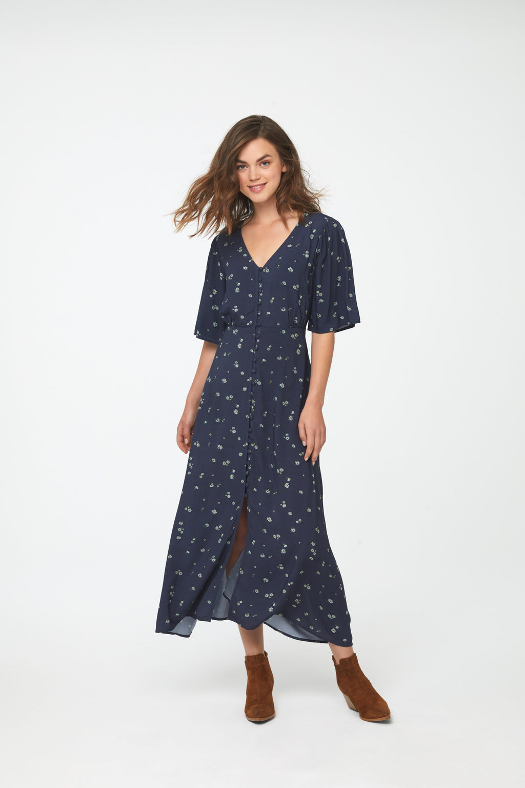 woman wearing navy-blue floral, A-line midi dress with front button v-neck and short flutter sleeves
