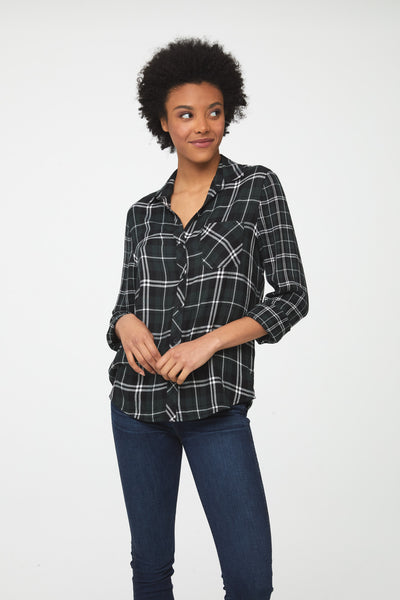 Woman wearing classic long sleeve, button-front shirt in forest green plaid