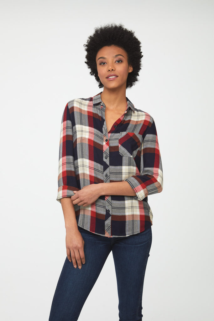 woman wearing a long sleeve, button-down, red white and blue plaid shirt with single chest pocket