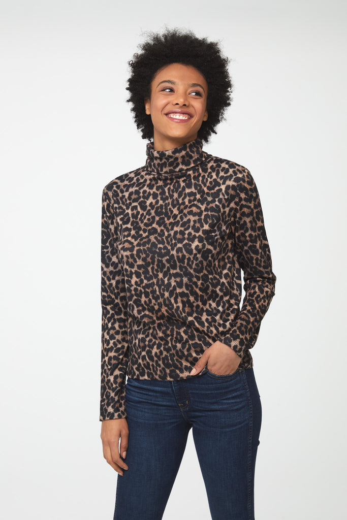 Woman wearing long sleeve, fitted, leopard print turtleneck sweater