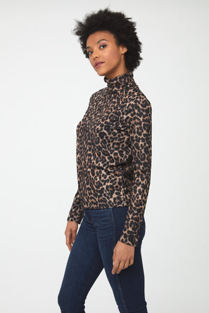 Side view woman wearing long sleeve, fitted, leopard print turtleneck sweater