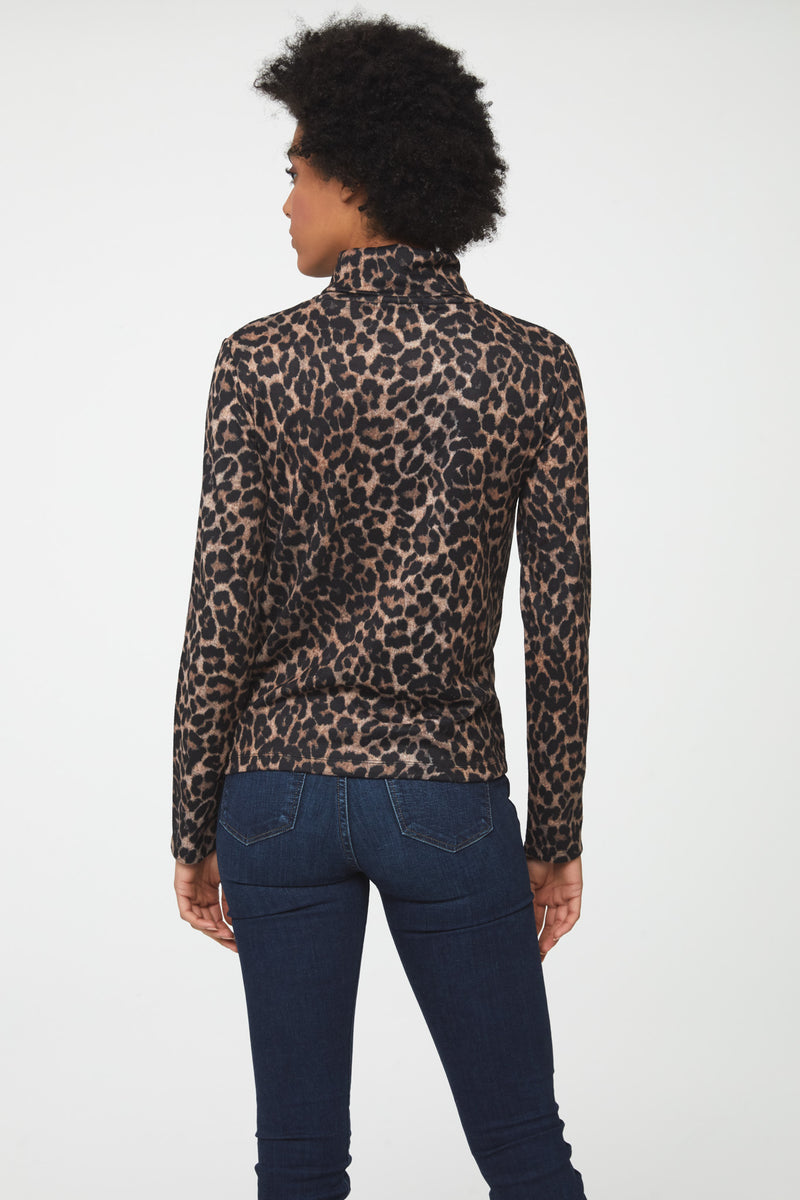 back view of woman wearing long sleeve, fitted, leopard print turtleneck sweater